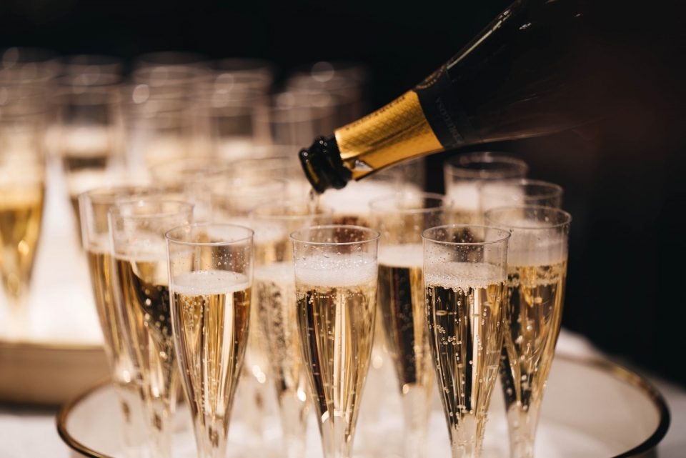 Pouring champagne after syndicate win