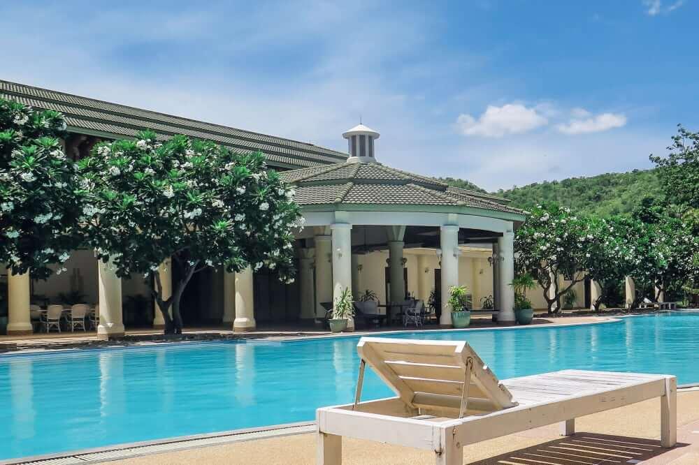 enjoying a luxury poolside resort after winning the US Powerball