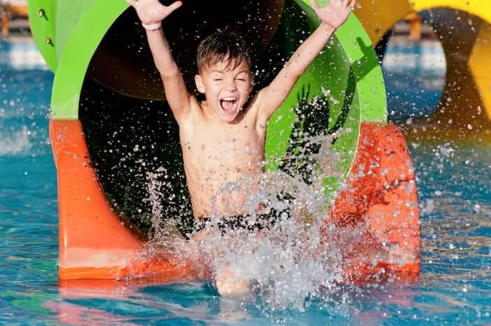 boy in water park
